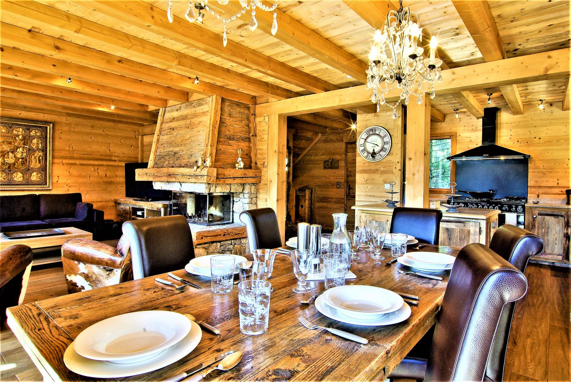 THE KITCHEN OPENS ON TO THE DINING AREA IN CHALET DES BOIS
