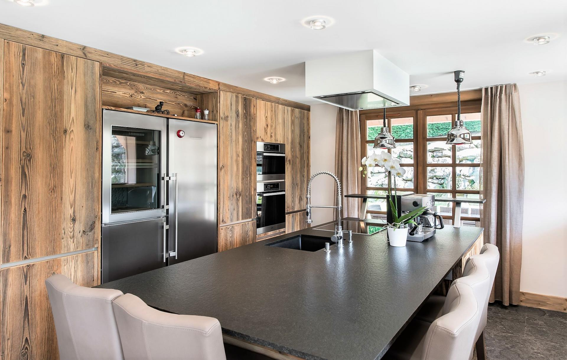 A BEAUTIFUL KITCHEN IN A SKI HOLIDAY CHALET IN MEGEVE