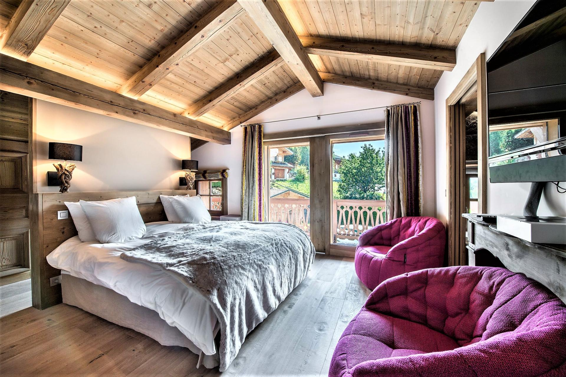 THE MASTER BEDROOM IN A CHALET RENTAL IN THE FRENCH ALPS